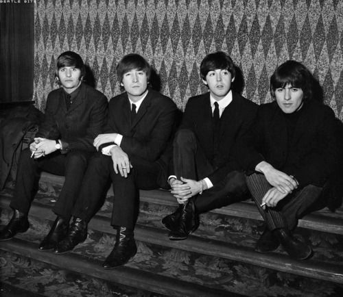 Ringo's face. And look how they sit. Paul and George are sitting the same way and John and Ringo are sitting the same way.
