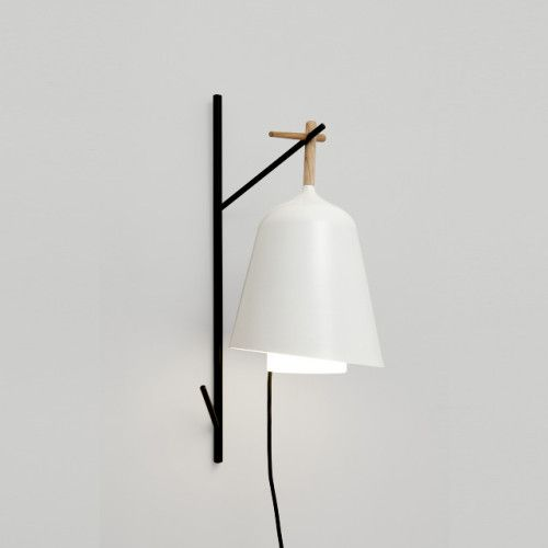 """Under My Tree Lamp is a minimalist design created by Paris-based designer Florian Brillet. Invited by Cinna / Ligne Roset to develop an idea for a garden lamp, Florian Brillet has created a portable light to hang from the branch of a tree. Made of metal and wood with a waterproof lantern, it is an invitation to a life outdoors, to summer evenings in the garden. Also available with a sconce, """"under my tree"""" may be suspended or placed on the ground. (1)"""