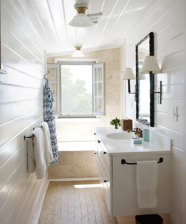 Narrow bathroom with glossy white tongue and groove walls for Bathroom ideas using tongue and groove