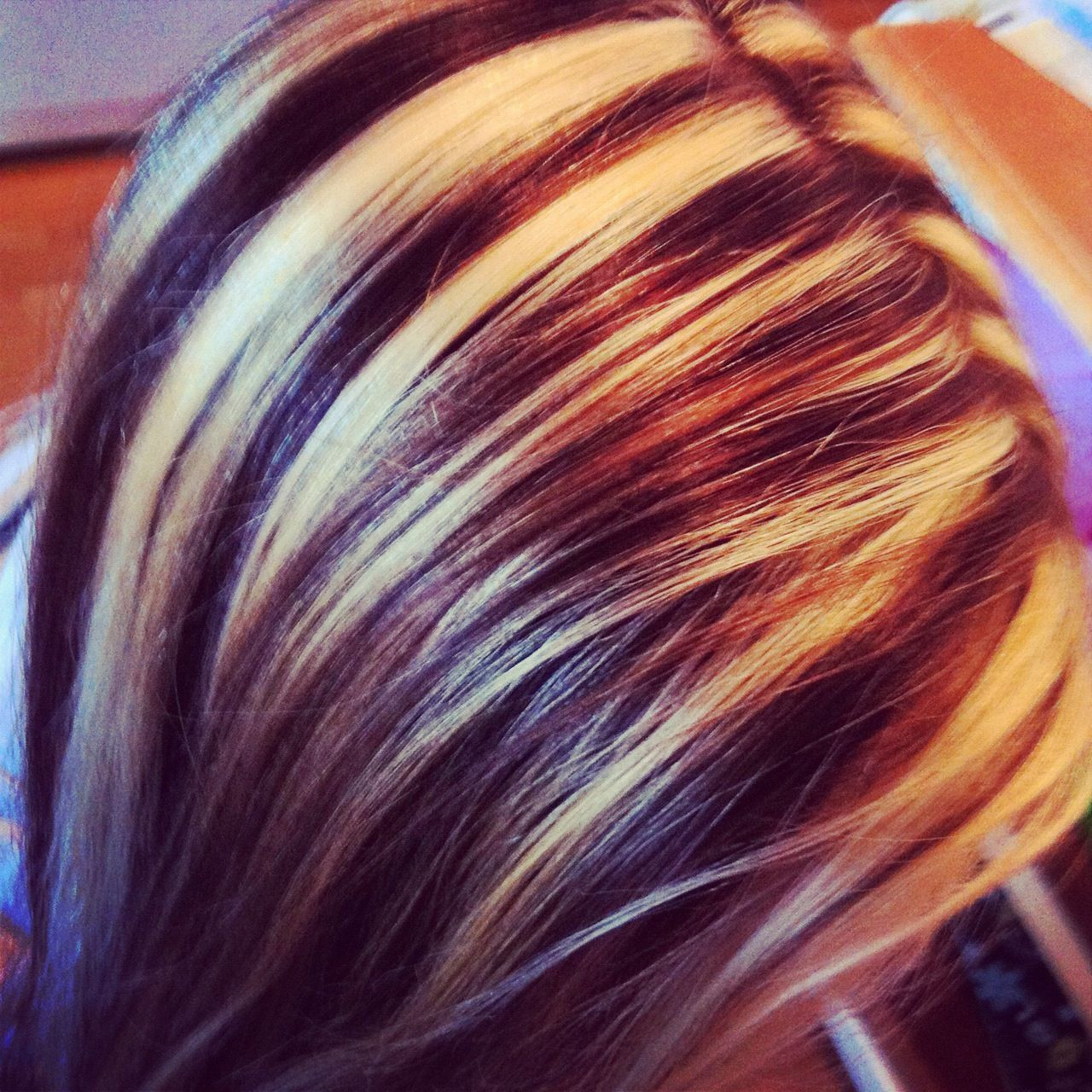 My friends hair i did chunky blonde and brown sliced high and low