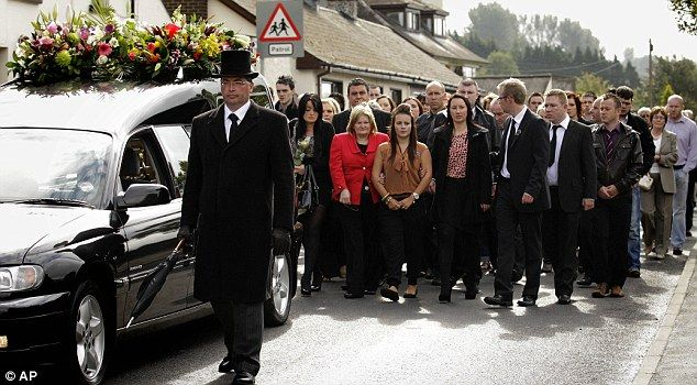 This is a funeral in Ireland. Funeral's are one of Ireland's biggest customs. Friends, family, and neighbors are welcome to come to funerals. About 99% of funerals are religious in some way. In Irish law, it states that there are two weeks of mourning after the death. If wanted to, the family can ask the funeral home to let the family keep the body in the house. The night before the burial starting at sunset, there is an all night service for the person who died. The service is call the…