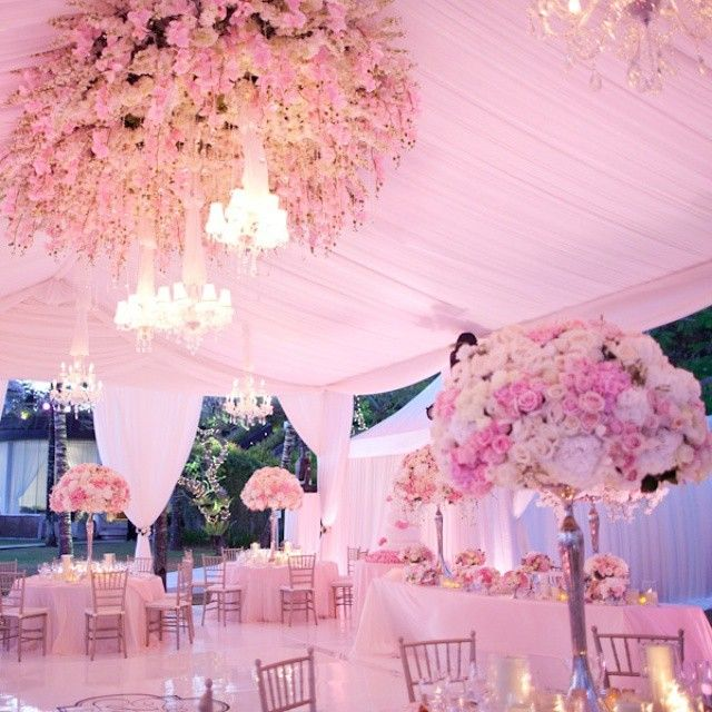 We love this beautifully decorated tent. The drapery and floral arrangements are stunning!