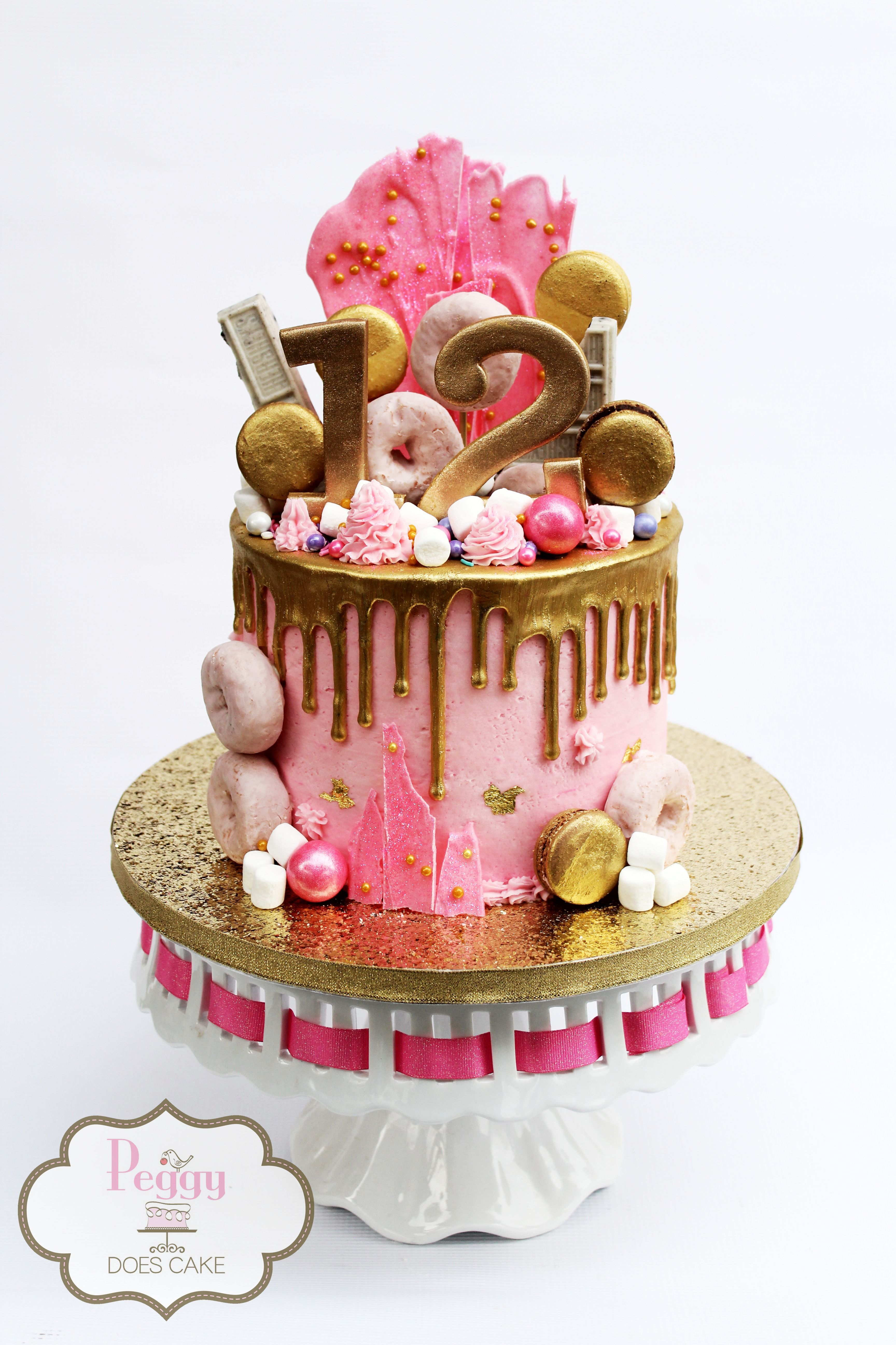 Pink And Gold Drip Junk Cake With Gold Macs For 12 Year Old