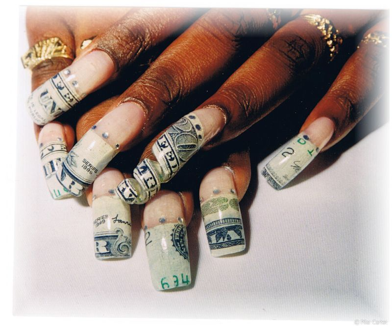 Chopped up twenty-dollar bill use for nail art on extreme length ...