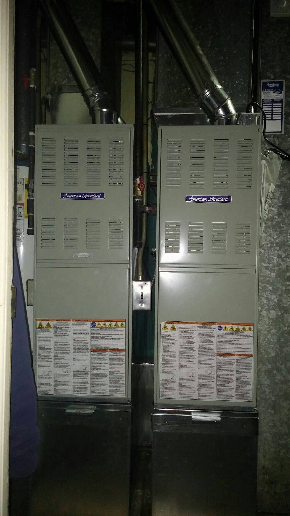 Here are 2 American Standard AUE1 furnaces mounted on