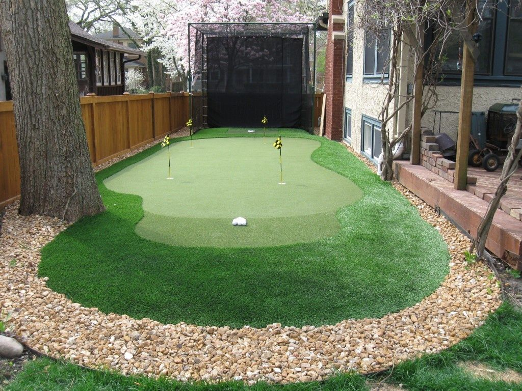 Traditional Landscape/Yard with Backyard Golf Cage, Fence ... on Putting Green Ideas For Backyard id=32798