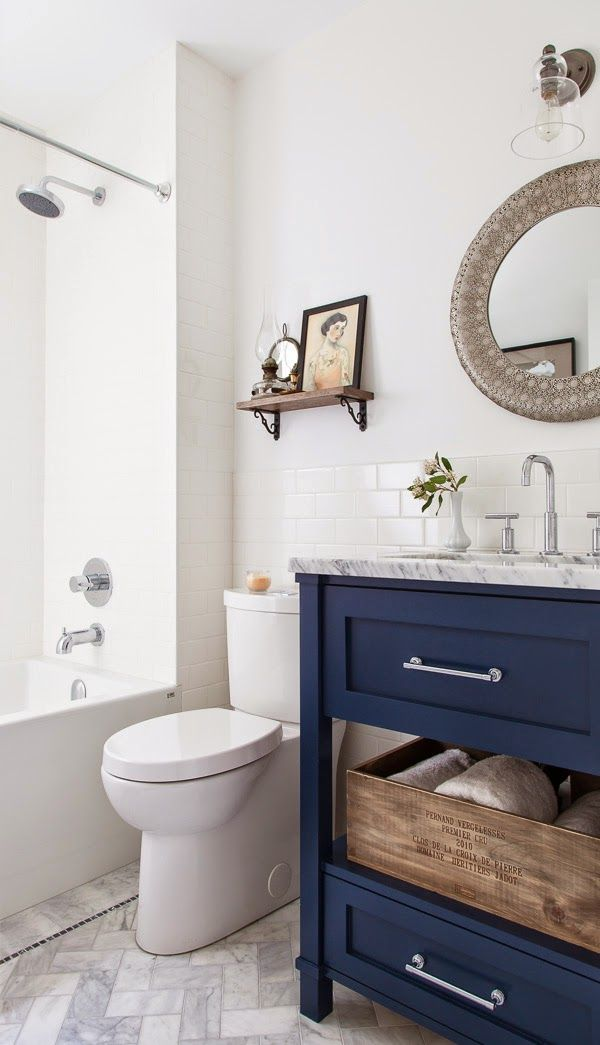 navy bathroom vanity in a white bathroom Whitebark remodel