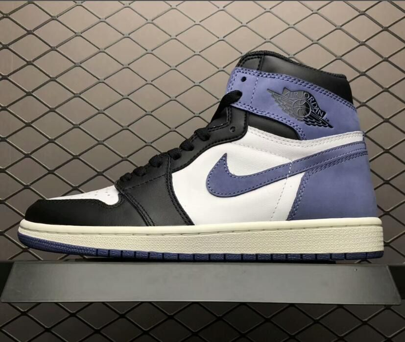 This 2018 Air Jordan 1 Blue Moon sneaker features a black and Summit White  leather upper 436cae8c1