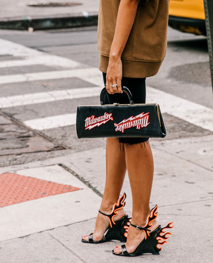 f241dddc6458 Trendy Shoes for FW18   SS19  Statement Heels. Prada flame wedges FW 2018  were street style trending during SS 2019 fashion weeks.