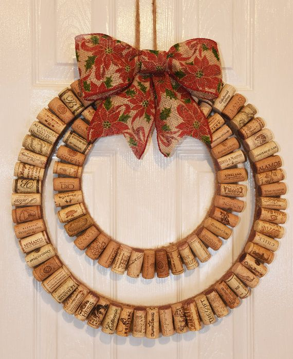 """Modern Wine Cork Wreath with Rustic Christmas Bow The wreath base is made of Eco-Friendly biodegradable foam wrapped in jute yarn with wine corks attached. The overall diameter measures 18"""" inches. It's completed with a 7"""" rustic Christmas holly burlap bow and comes ready to hang. The bow is easily removable, making this wreath usable all year round!"""
