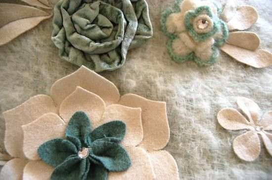 embellish throws- why haven't I thought to do this??? Great idea for gifts- felt flowers or buttons, design and attach!