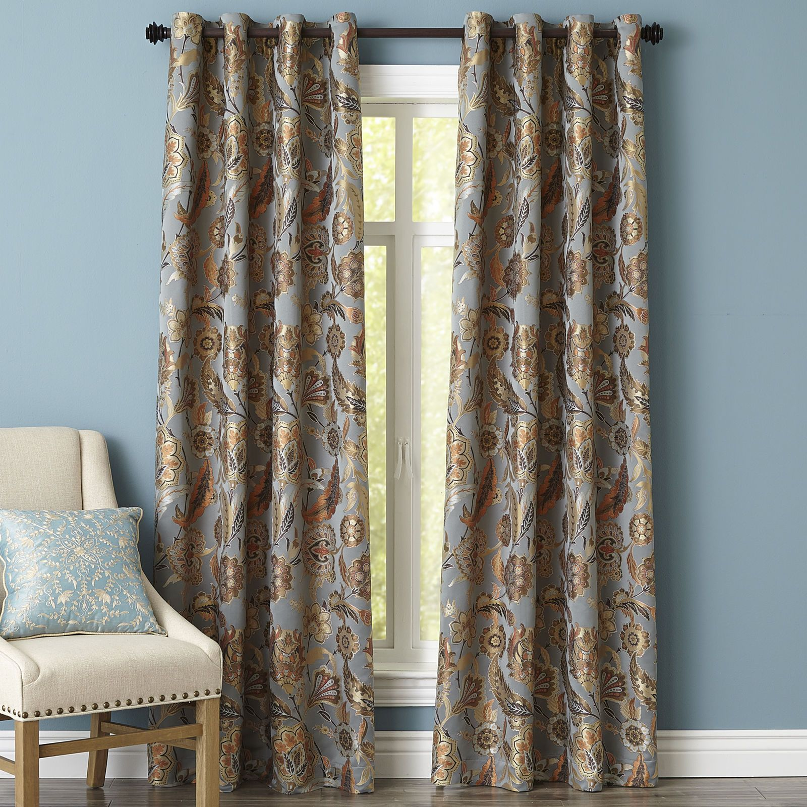 Woven jacquard highlights the details of this classic floral pattern. A smoky blue background shines with shades of gold, burnt orange and neutral wheat tones.