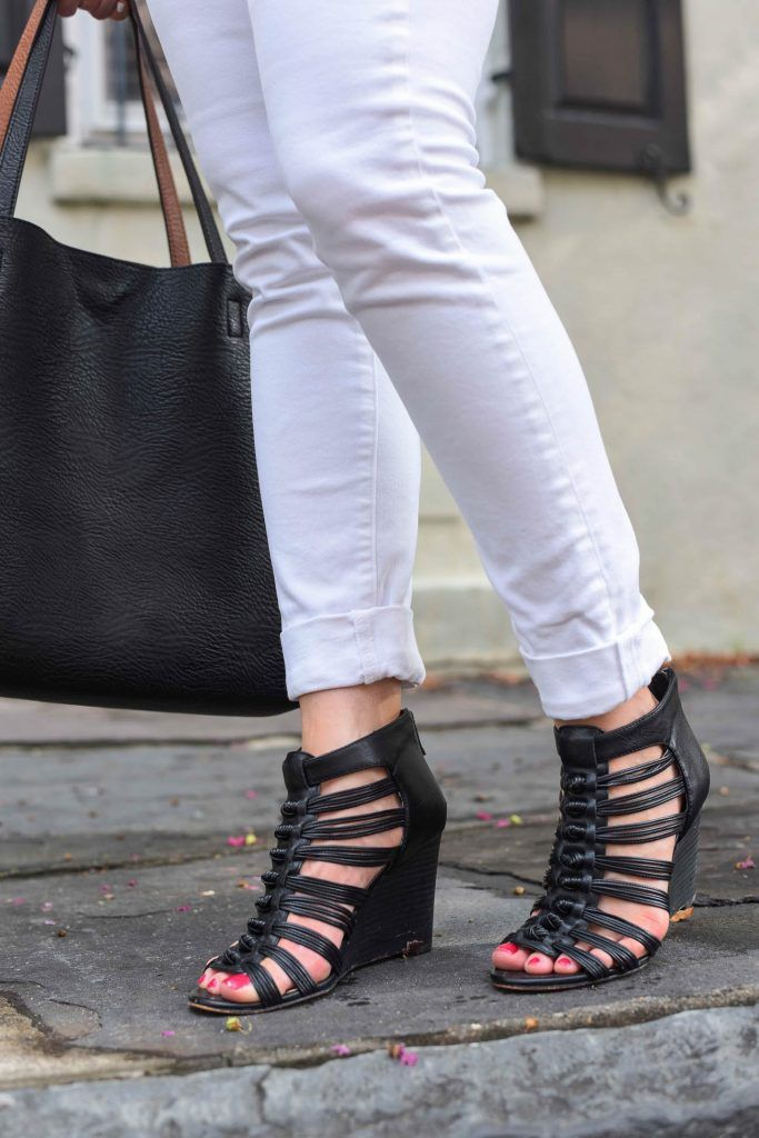 caged black wedge sandals with rolled white skinny jeans