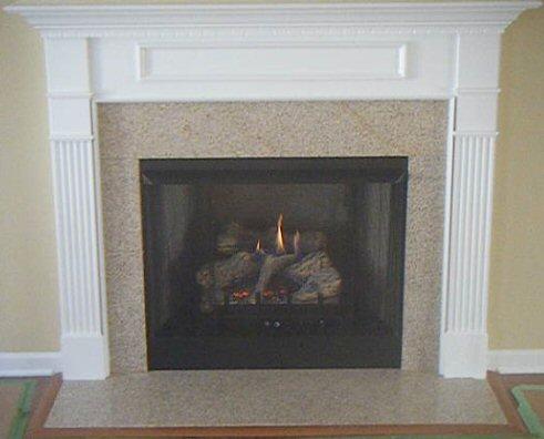 Wheatfield Granite fireplace surround with Dogwood style mantel ...