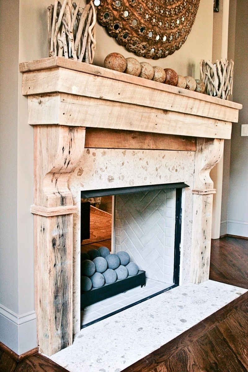 Hand crafted reclaimed wood mantle by farmhouse luxury interiors