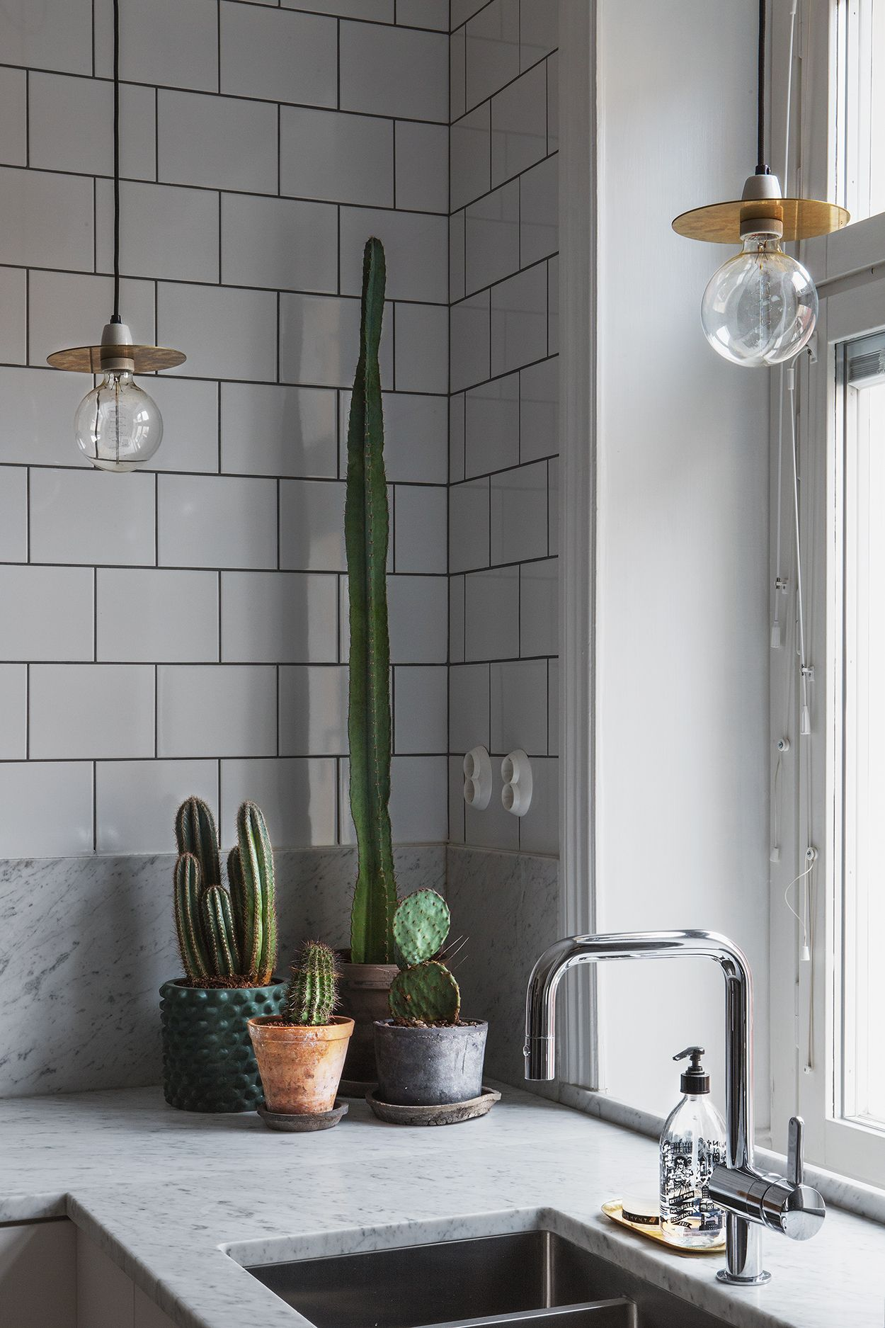 "marble with subway tiles is a nice ""opposites attracts"" kind of combo. The dark grout pulls it all together."