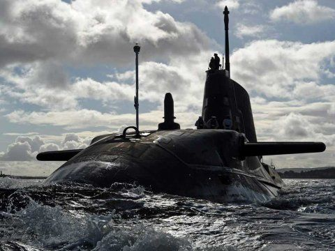 HMS Astute sailing to Faslane Naval Base in Scotland