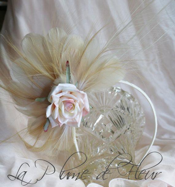Bowerbird feather fascinator attached to by LaPlumeDeFleur