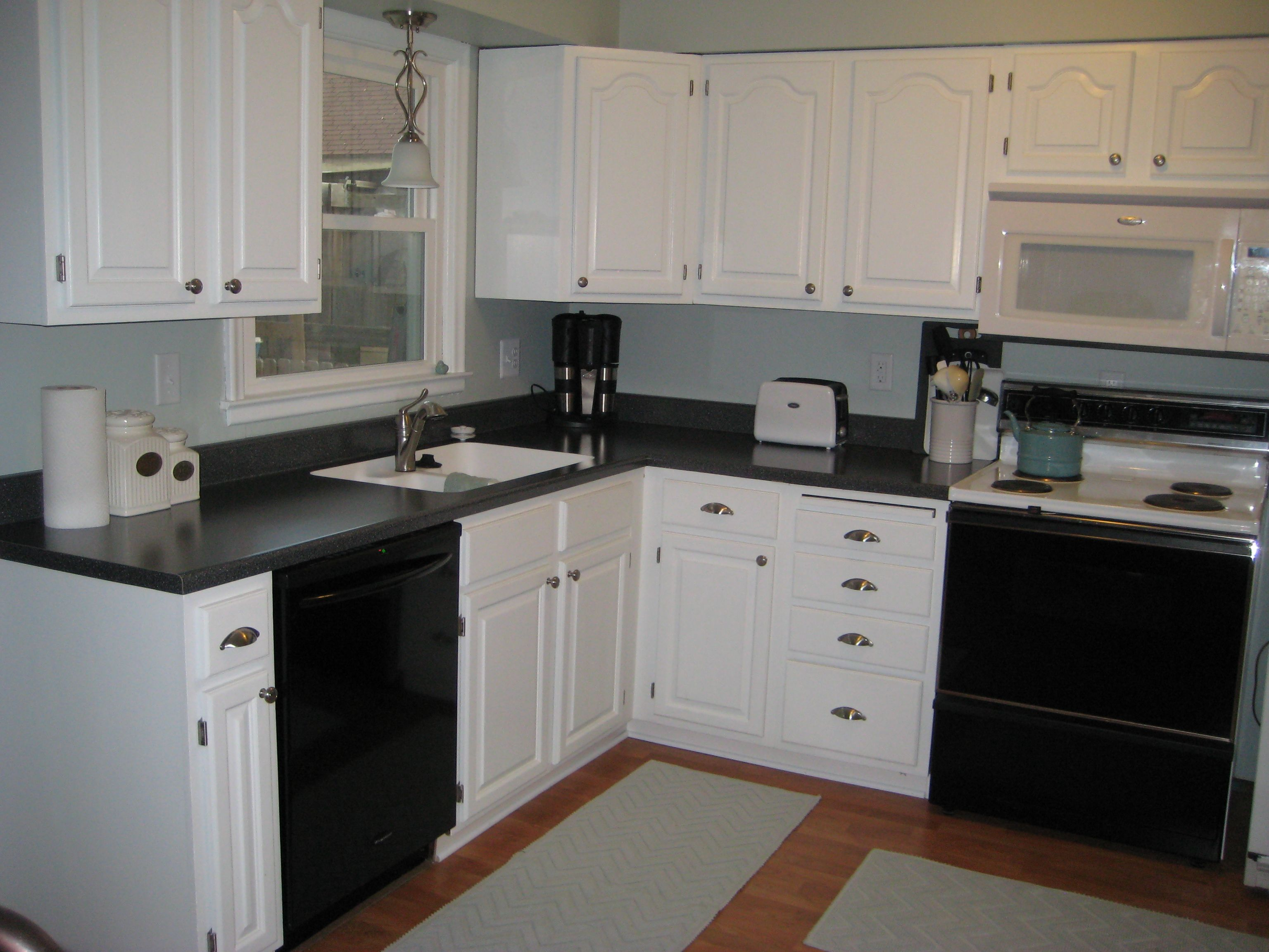 white cabinets black counters kitchens dining rooms