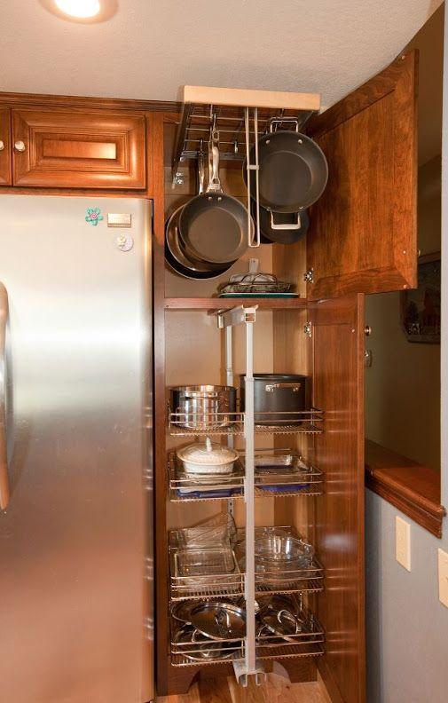 POT & PAN PULLOUT in tall cabinet, Revashelf. By Swita Cabinetry.
