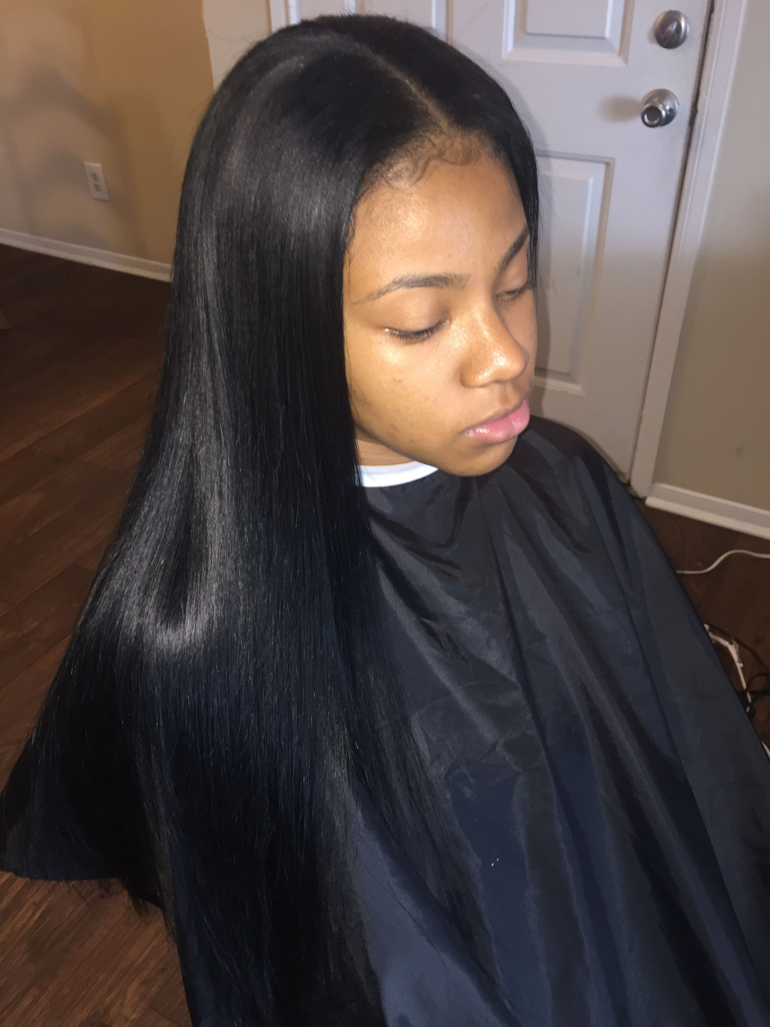 bone straight brazilian weave. middle part sleek sew-in