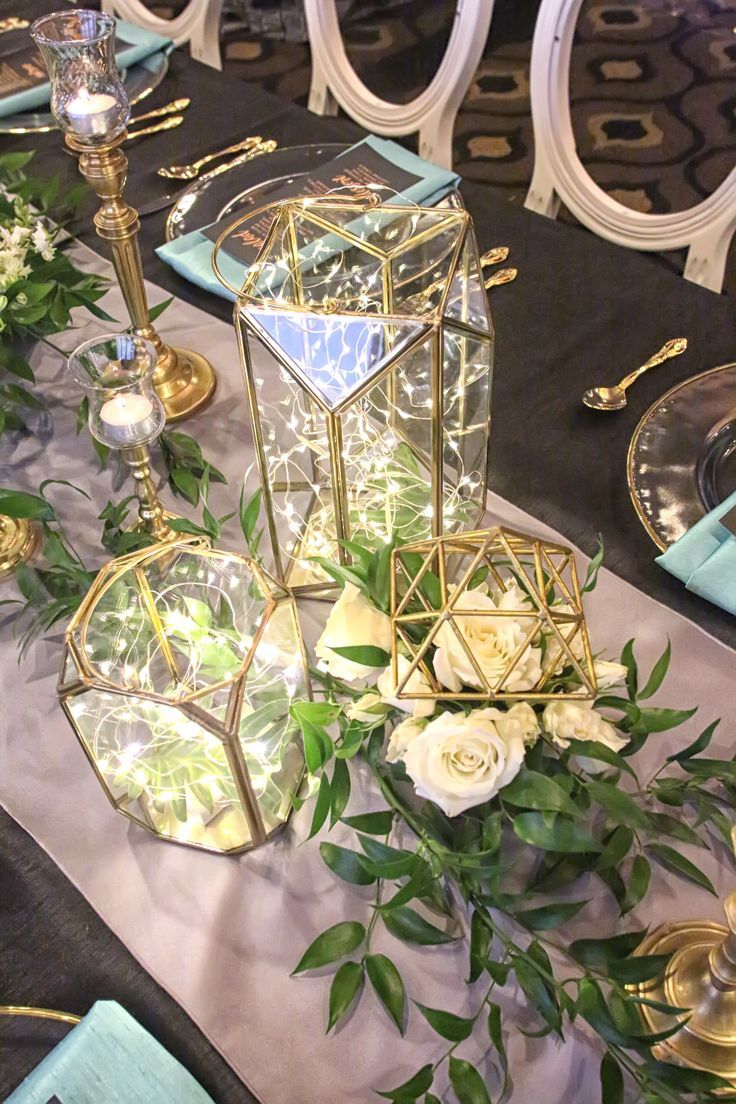 Table centerpiece design and floral by lana with http