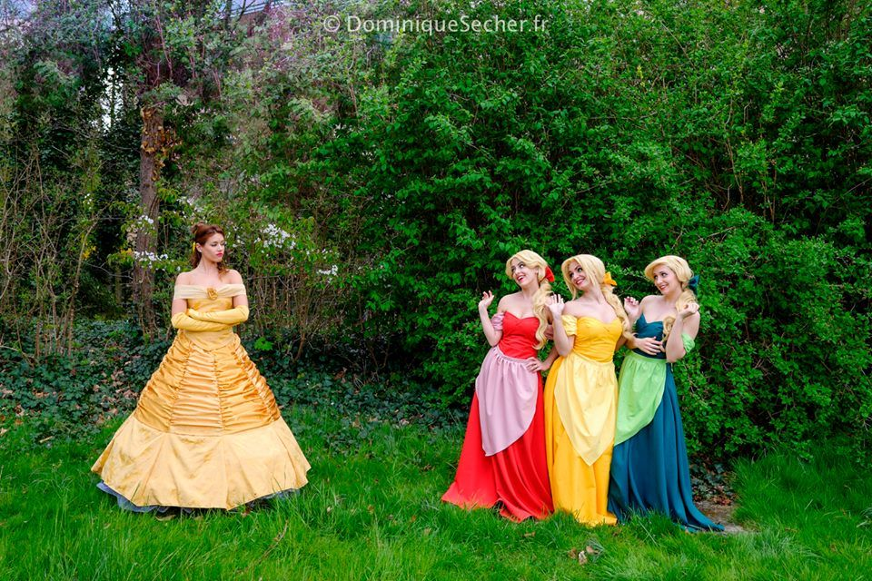 Here are our cosplays from Beauty and the Beast ! Lexi is Belle I am Claudette (the red one) Nuna is Laurette (the yellow one) Pandora Clemy is Paulette (the green one) Photo by Dominique Sec...