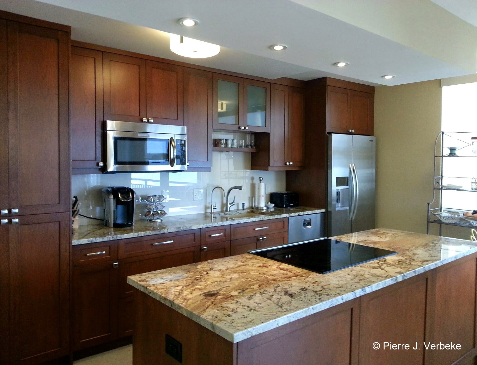Whitehall Unit 10 E The Stylish New Kitchen Features Extra Tall Cabinets Gorgeous Granite Countertops Tiled Back Splash Top Of Line Stainless Steel