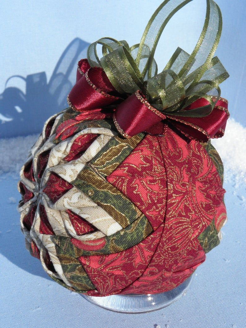 Tutorial Blazing Sun Ornament In 2021 Quilted Christmas Ornaments Folded Fabric Ornaments Fabric Ornaments
