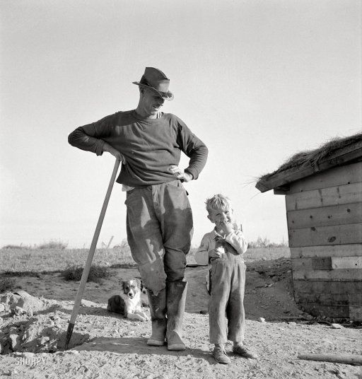 October 1939. Mr. Dougherty and one of the children. Warm Springs district, Malheur County, Oregon. Photo by Dorothea Lange.