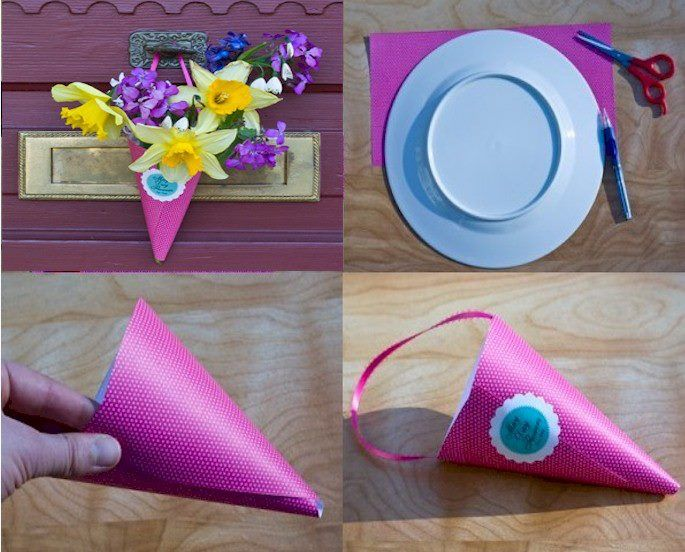 """Make a May Day Basket and deliver to neighbors anoymously.   Use12""""x12"""" heavy paper or doubled gift wrap paper. Cut it in half.   It should measure 12″x6″. Using a dinner plate as a guide, draw a half circle on the paper. Cut out with scissors.   Holding both ends of your half circle, bring them together and overlap to make a cone shape. Secure with a stapler, tape or glue.   Secure a ribbon for a basket handle, using tape.   You can add an anonymous message card, """"Happy May Day""""."""