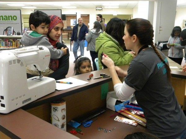 A family exploring sewing basics at Piscataway Library.