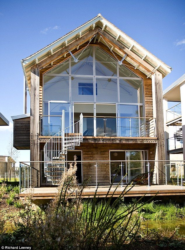 The rear balcony of Aspen Lodge, a four-bed, four-bathroom timber-clad lakeside home in th...