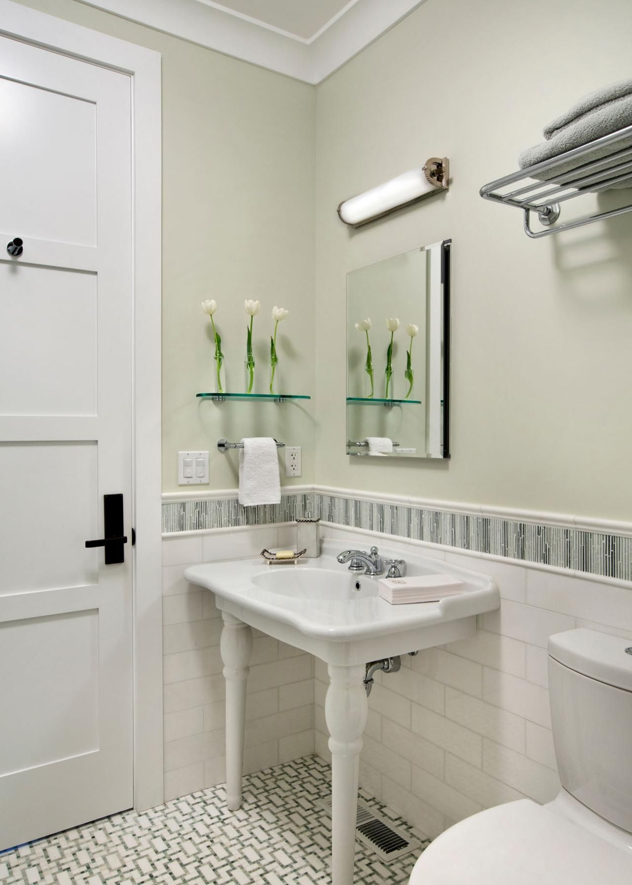 This minimalistic bathroom features light gray walls and white ...