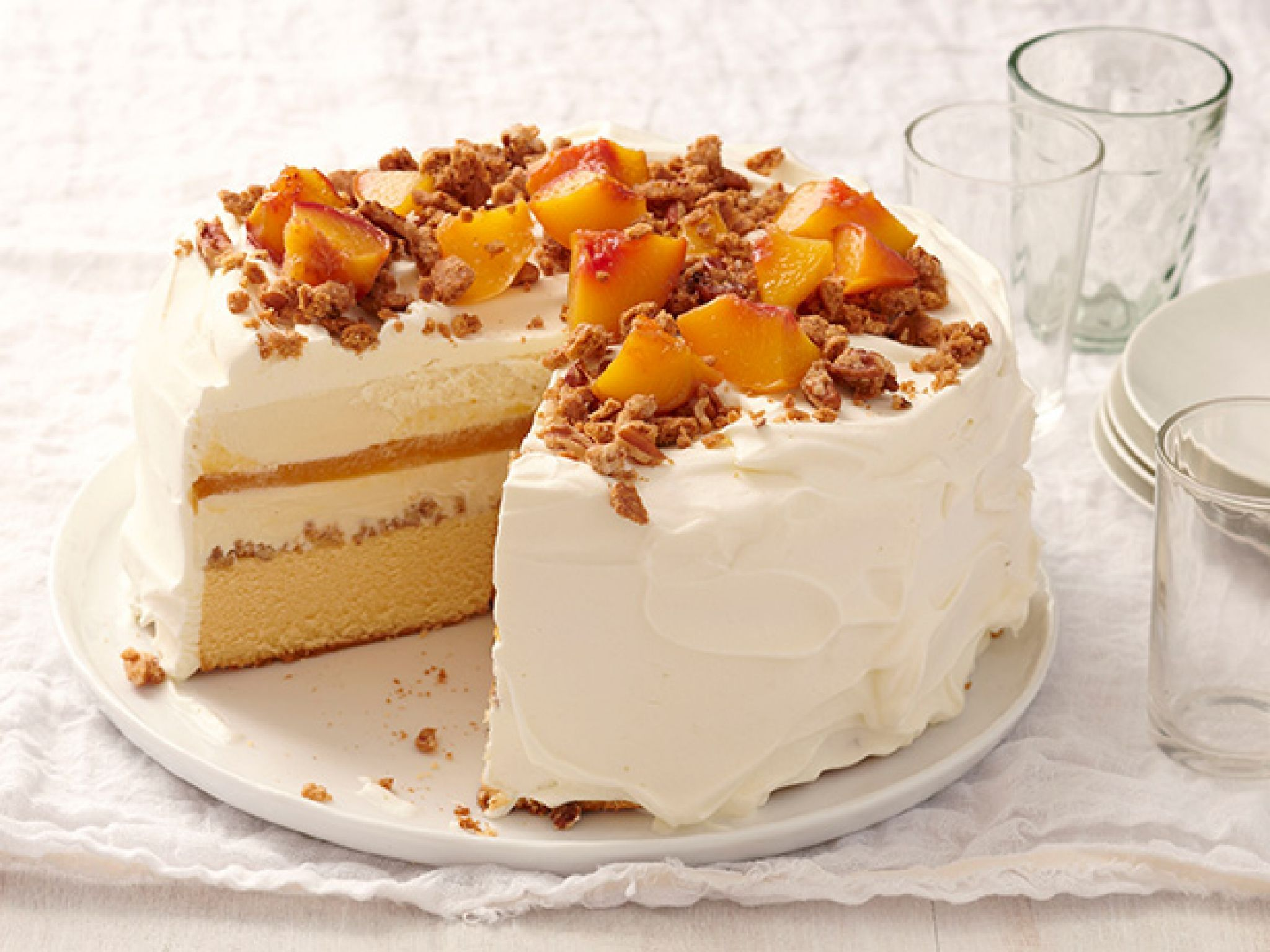 Best Summer Fruit Desserts #peachcobblerpoundcake Peach Cobbler Ice Cream Cake : Layer ice cream with freshly made peach puree, pound cake and pecans for a frozen dessert that tastes just like the classic summer cobbler. #peachcobblerpoundcake