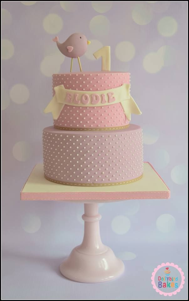 cute 1st birthday cake with birdy topper