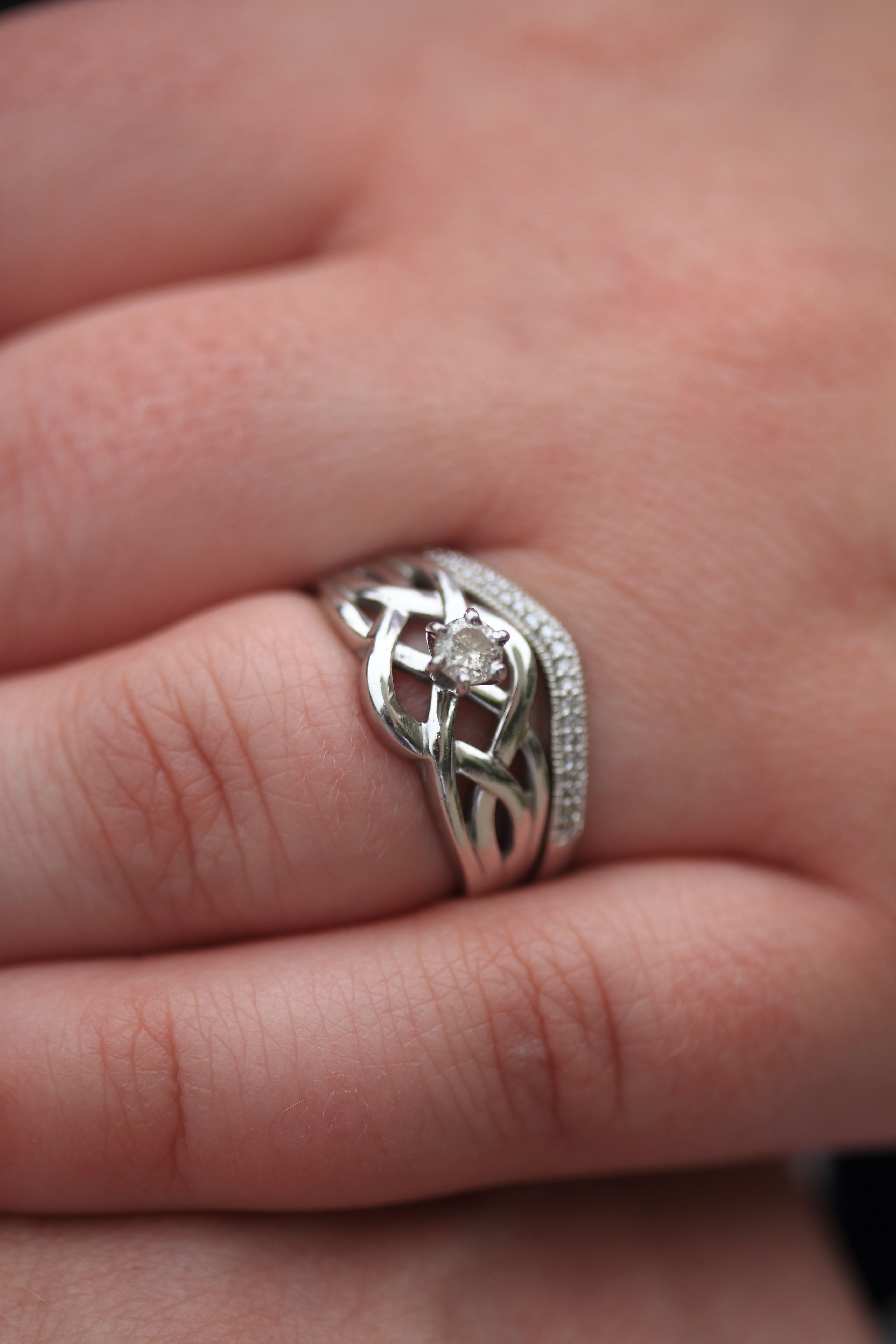 Sort of Celtic knot engagement ring with diamond and diamond studded ...