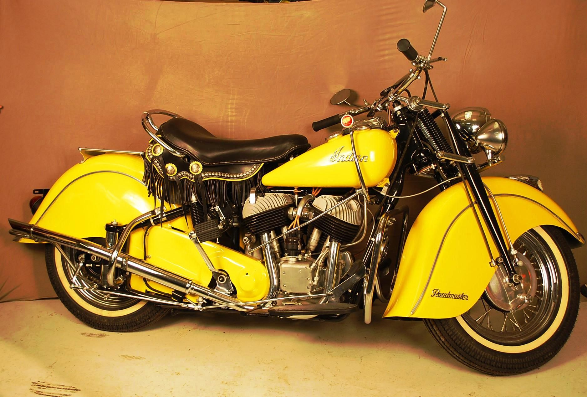 This yellow 1948 Indian Chief Roadmaster motorcycle sold