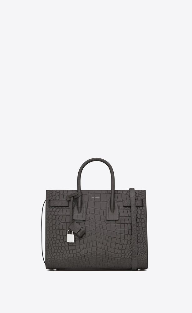 43e6f1d60f Shop Bottega Veneta® Women s LIGHT GRAY INTRECCIATO NAPPA BABY OLIMPIA BAG.  Discover more details about the item.