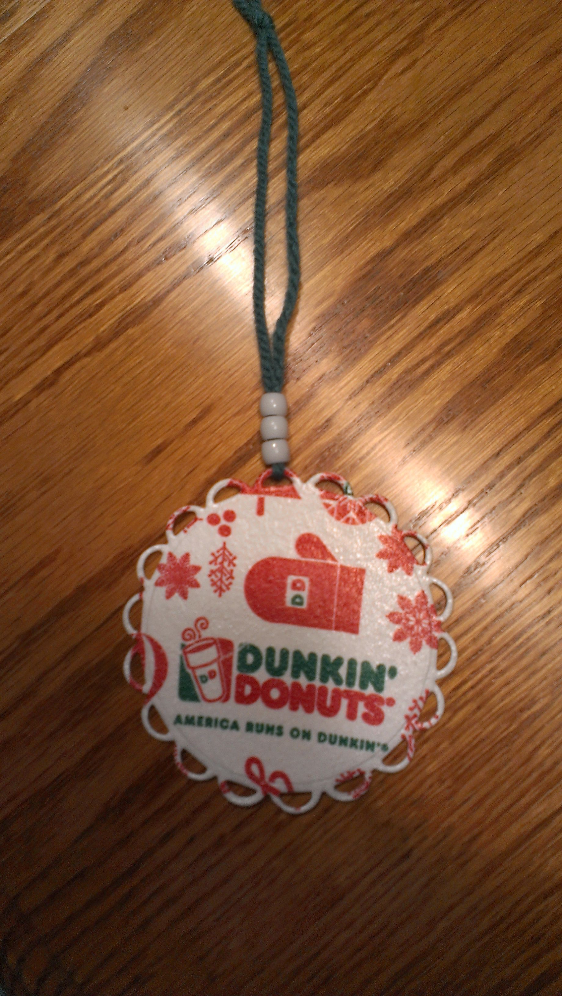I made this ornament out of a Dunkin Donuts cup and my Cuttlebug. Doug will give it to the Dunkin Drive-thru girl who serves him his coffee every day.