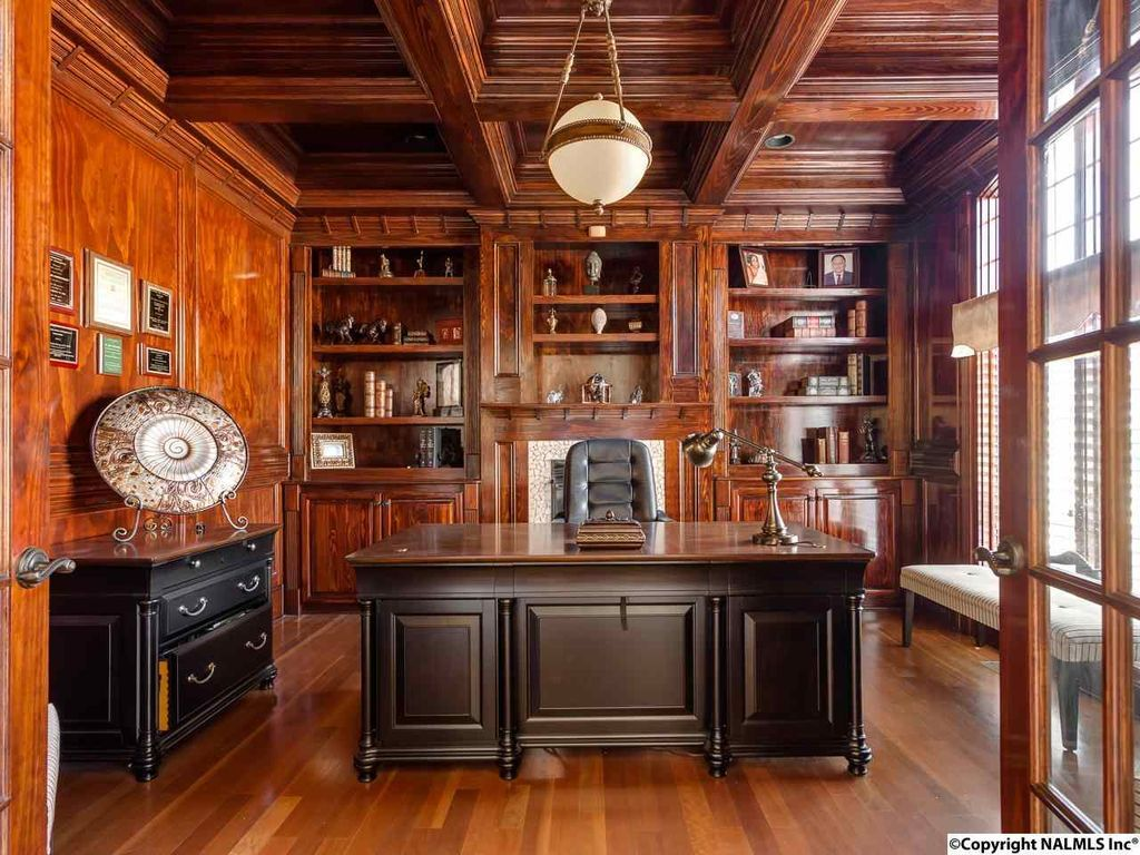 Traditional Home Office with Builtin bookshelf, flush