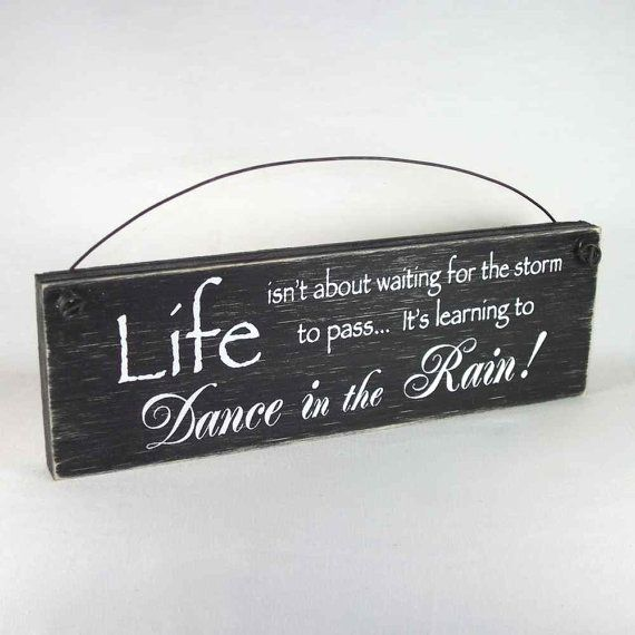 Sign  Life isn't about waiting for the storm to by obxcountrystore