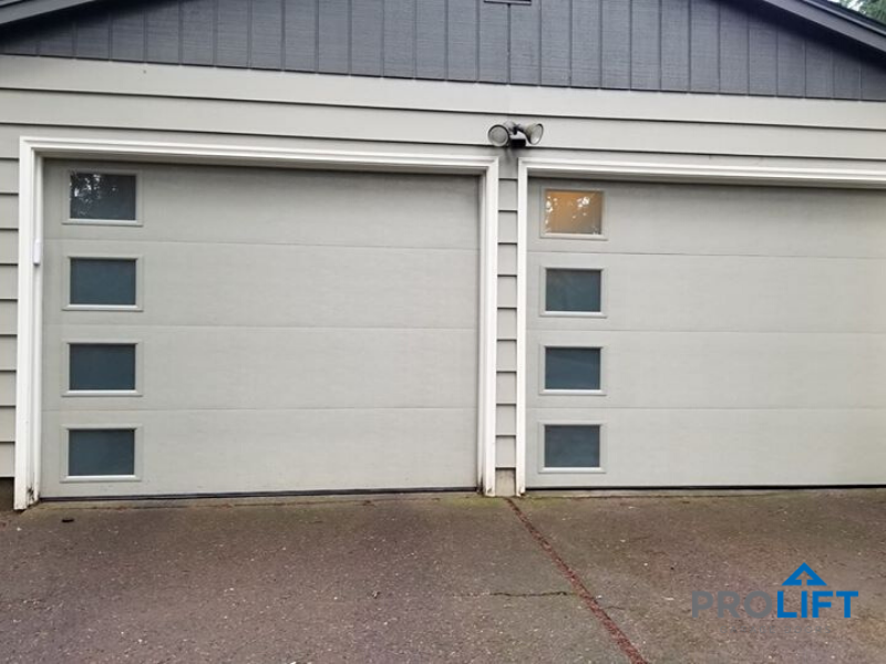 Contemporary Garage Doors With Etched Windows In 2020 Garage Doors Modern Garage Doors Garage Door Windows
