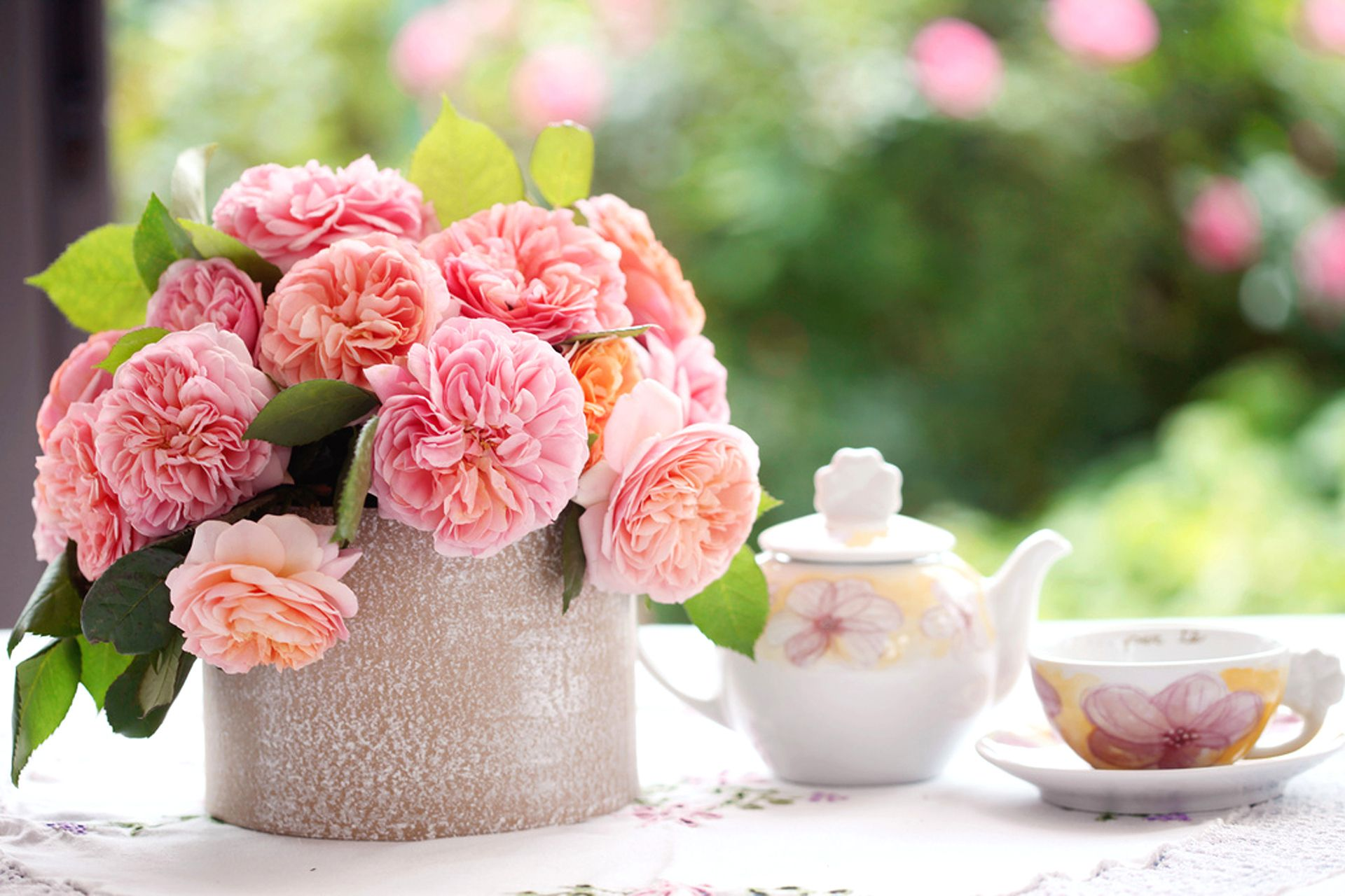 table in afternoon with pink rose on bokeh green