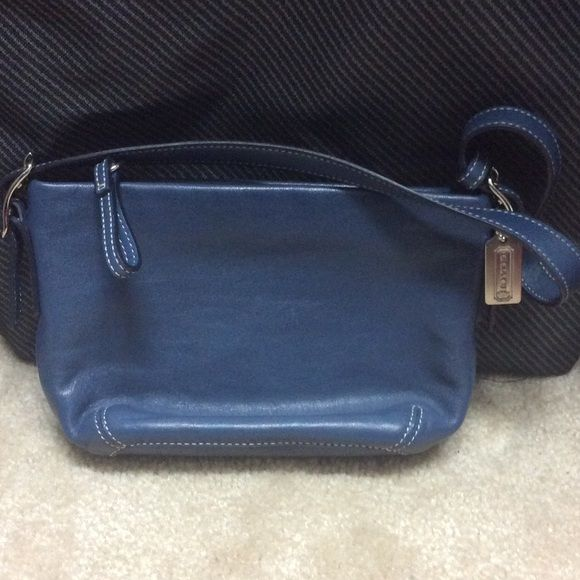"""SUNDAY ONLY-SALEMini blue coach purse I love this blue Coach color. Small purse 7.5""""x5"""". Could be for a younger tween. Or use to hold those little items in your bag. Strap is 19"""" and has adjustable buckle. Looks like new. It was too small for me! Cute, cute, cute! Coach Bags Mini Bags"""