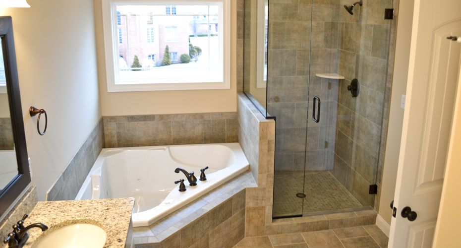 Master Bath With Granite Countertops Stand Up Shower With A Shelf And Large Tub With Oil