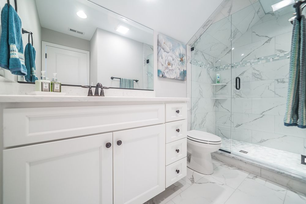 Stunning Marble Bathroom With White Cabinets House For