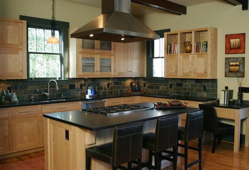 clear coat maple craftsman kitchen with black marble countertop