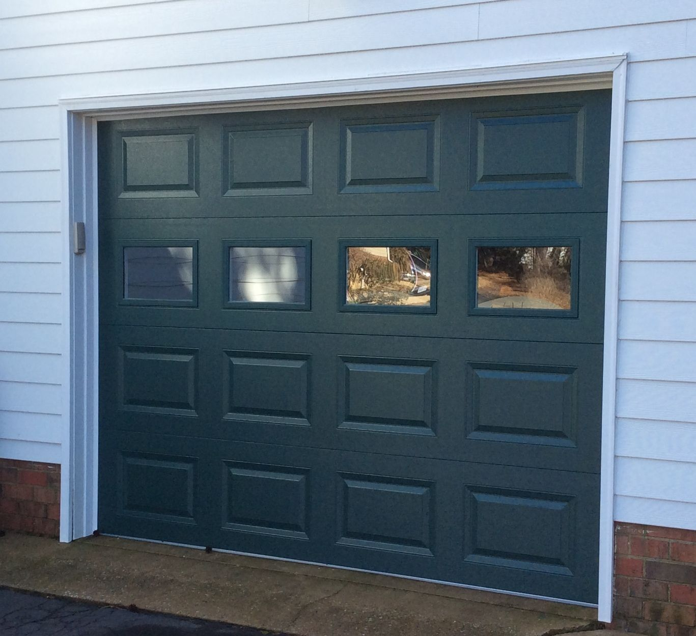 9x7 model 2216 raised panel garage door with 3rd row plain glass 9x7 model 2216 raised panel garage door with 3rd row plain glass installed by the richmond rubansaba