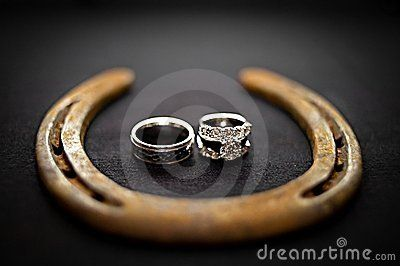 Two Beautiful Wedding Rings Sitting Inside A Rustic Horseshoe Taken During Texas Western Style Reception